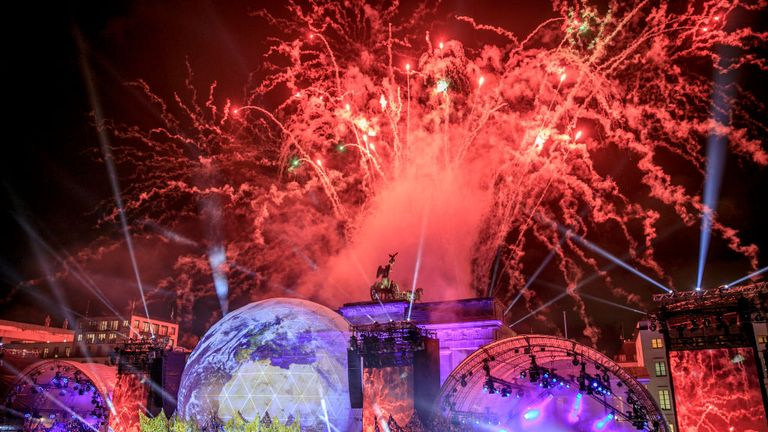 Fireworks erupt over the Brandenburg Gate