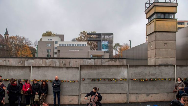 A cellist performs at the Berlin Wall memorial in Bernauer Strasse