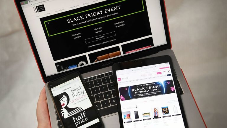 A picture taken in Liverpool, north west England on November 22, 2018 shows Black Friday sales branding on shopping websites displayed on smartphone, tablet and laptop screens. - Black Friday is a sales offer originating from the US where retailers slash prices on the day after the Thanksgiving holiday. In the UK it is used as a marketing device to entice Christmas shoppers with the discounts at stores and online sometimes lasting for a week. (Photo by Paul ELLIS / AFP) (Photo credit should read