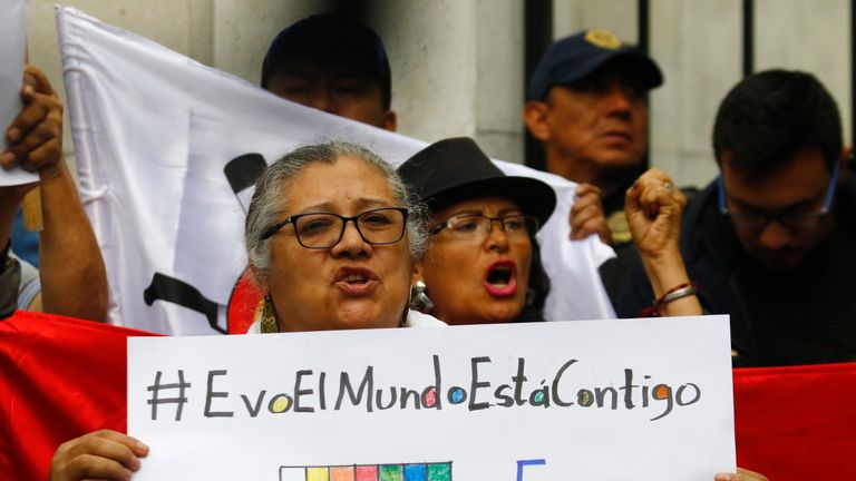 People demonstrate in support of Bolivian ex-president Evo Morales in front of the Bolivian embassy in Mexico City