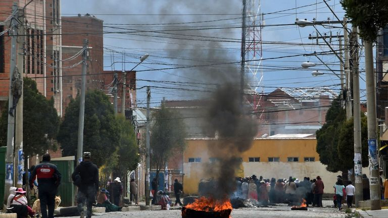 Pro-Evo Morales protesters block a street in El Alto, a day after he resigned following a disputed election