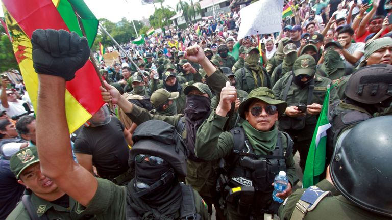 Police officers, who have joined a rebellion, take part in a march to protest against Bolivian President Evo Morales in Santa Cruz, Bolivia