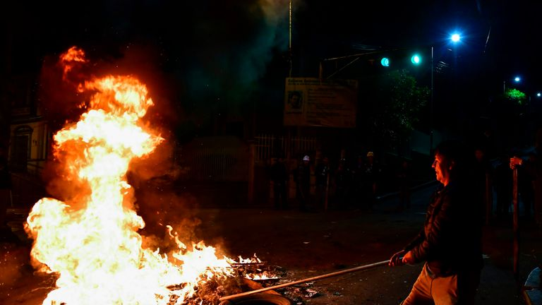 Protesters set fires n the Bolivian capital, La Paz, after president Evo Morales announced his resignation