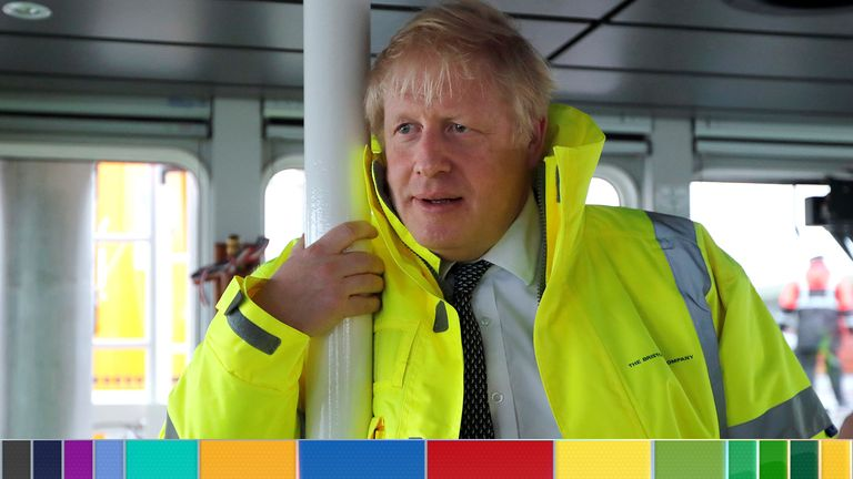 Boris Johnson leans on a pole in the steering cabin of a tugboat in the port of Bristol