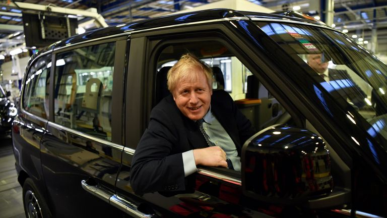 Prime Minister Boris Johnson sits in an electric taxi during his Conservative party general election campaign visit to the London Electric Vehicle Company (LEVC) in Coventry on November 13, 2019