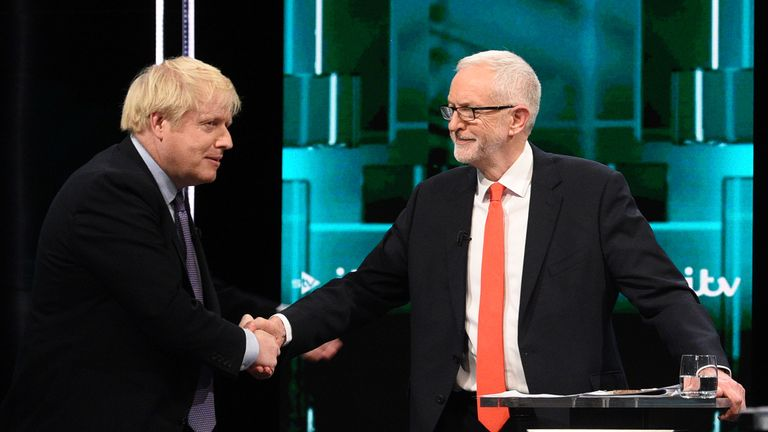 Boris Johnson and Jeremy Corbyn shake hands on a pledge to improve the tone of political debate