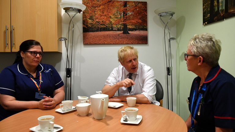 PM Boris Johnson talks with nursing staff during a general election campaign visit to King's Mill NHS Hospital