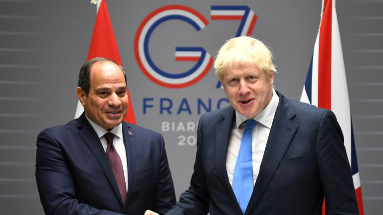 Boris Johnson shakes hands with President Abdel-Fattah el-Sisi during the G7 summit in August