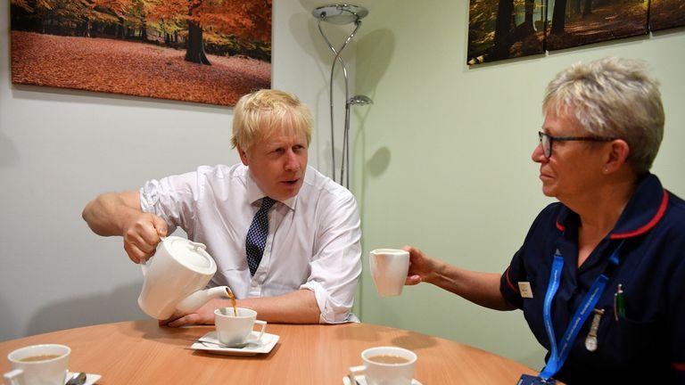 Britain's Prime Minister Boris Johnson pours tea