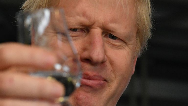 Boris Johnson tastes whisky during a general election campaign visit to Diageo's Roseisle Distillery near Elgin, Scotland