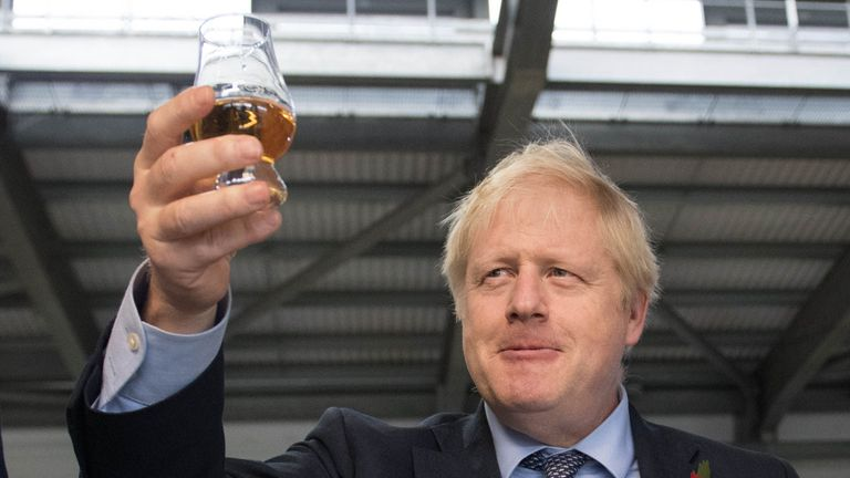 Boris Johnson tastes whisky at the Roseisle Distillery in Scotland near Moray at the start of the General Election campaign