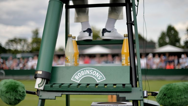 Bottles of Robinsons juice can be seen on the Umpire's chair during day three of the Wimbledon
