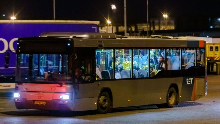 A bus with refugees drives away from the DFDS ferry, in the harbour of Vlaardingen, The Netherlands