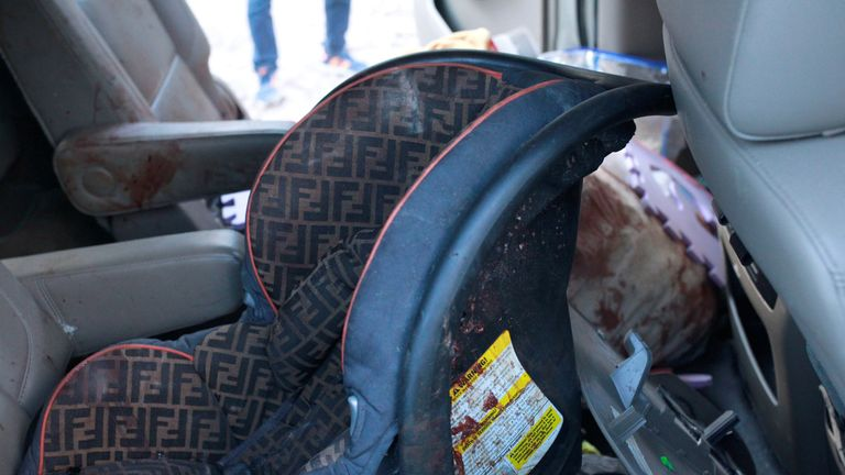 A car seat pictured at the scene following the deadly attack