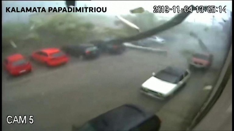 Camera footage from a factory belonging to the food processing company Kalamata Papadimitriou, a major producer of balsamic dressings in Greece, shows violent winds sweeping through the factory parking lot and striking the building, sending aluminium panels and other debris into the air.