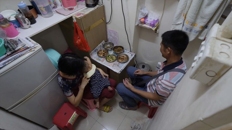 A family eats in their tiny space