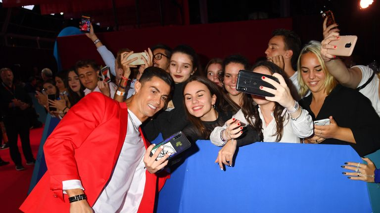 Footballer Cristiano Ronaldo met fans on the red carpet before taking his seat in the audience