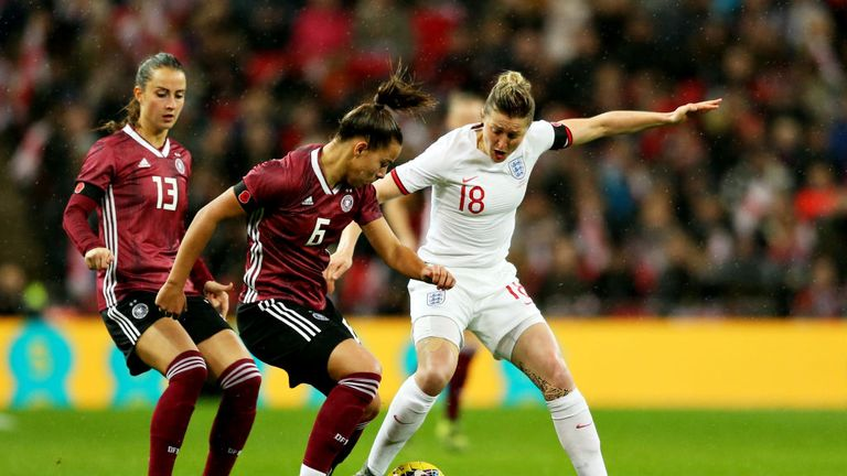 Ellen White of England and Lena Oberdorf of Germany battle for the ball