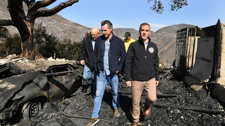 Los Angeles mayor Eric Garcetti (L) and and California Governor Gavin Newsom inspect damage from wildfires in Brentwood, California
