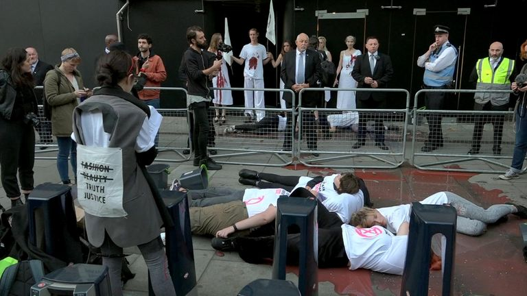 Rebels glued themselves to doors at London Fashion Week and staged a 'die-in'