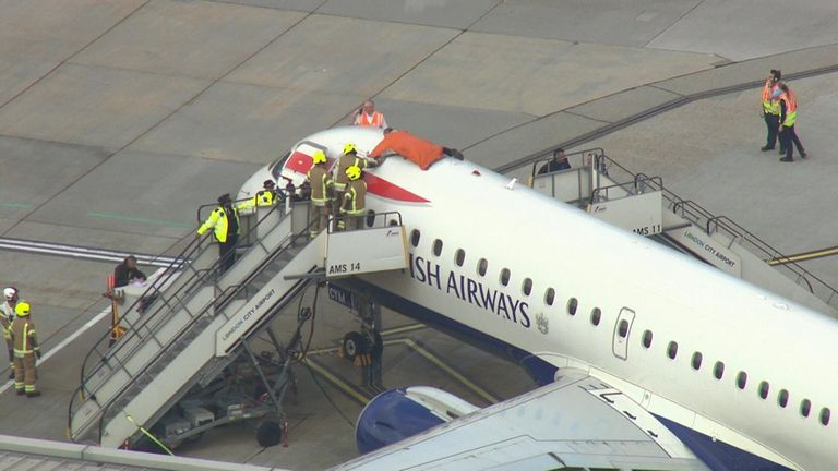 A protester climbed on top of a British Airways plane at City Airport in October