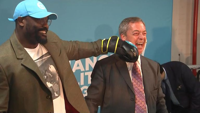 Nigel Farage poses with Dereck Chisora at a Brexit Party event in Dagenham.
