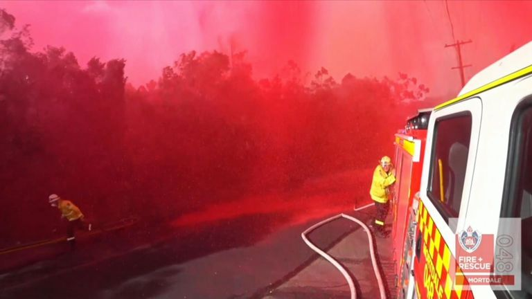 Firefighters caught in fire retardant drop