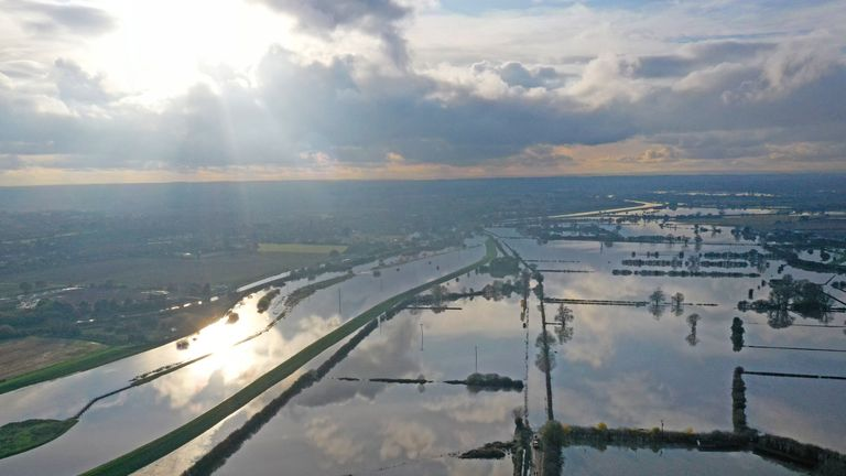 The flood water at Fishlake, in Doncaster, South Yorkshire, as parts of England endured a month's worth of rain in 24 hours, with scores of people rescued or forced to evacuate their homes