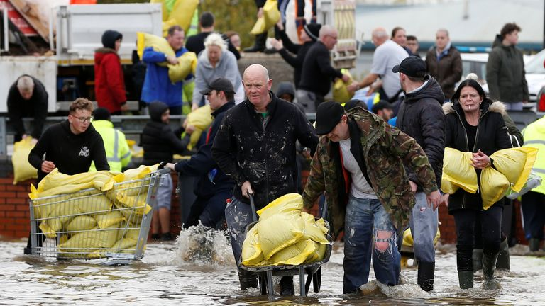 Residents collect sandbags in a flooded area of Bentley, north of Doncaster