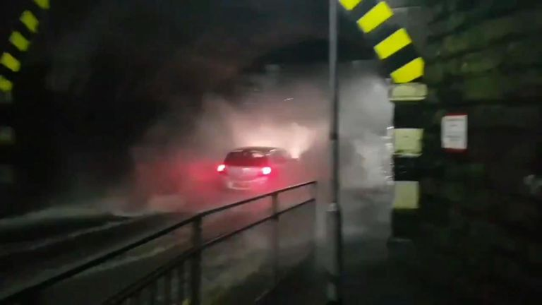 A car got stuck in floodwater in Rotherham as South Yorkshire experienced severe flooding after heavy rain.
