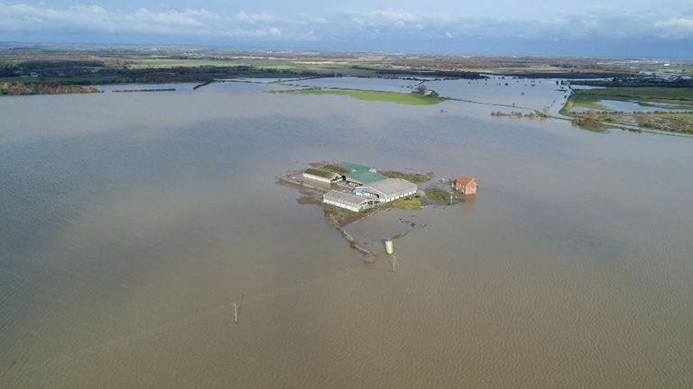 A farm has been cut off by floodwater after a river in Lincolnshire flooded following torrential downpours over the last few days.