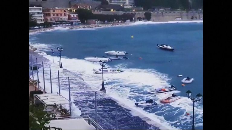 Giant waves crashed over the coastline of southeastern France, with flooding and storms lashing the region.