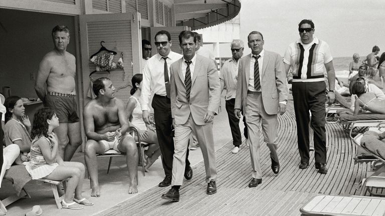 Frank Sinatra, with his minders and his stand in while filming, The Lady in Cement. Pic: Terry O'Neill/Iconic Images