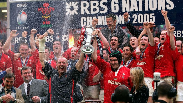 Gareth Thomas (centre left) holds the Six nations trophy after winning the Grand Slam in 2005