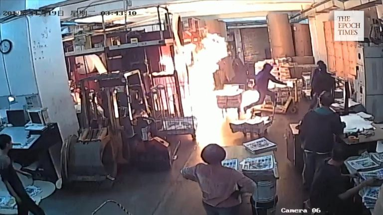 Four masked men entered the Hong Kong Epoch Times print shop before threatening workers and setting a fire