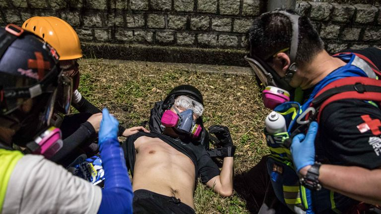 Medics treat a protester during clashes with police at CUHK