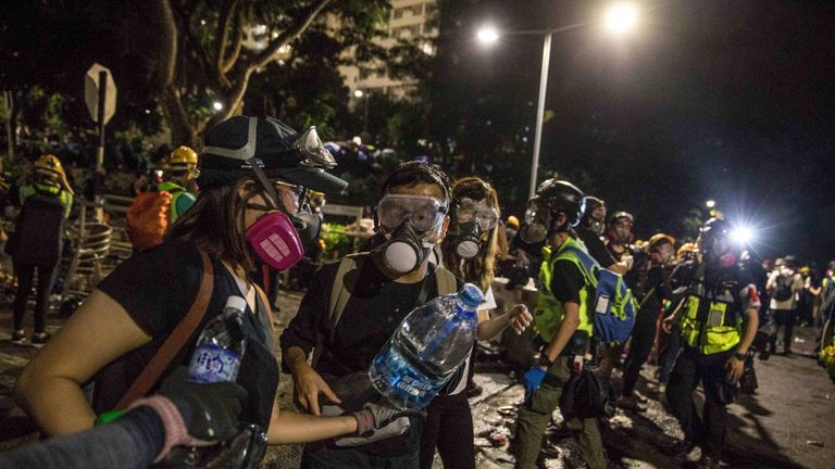 After five months of protests, people come equipped with water, gas masks and snacks