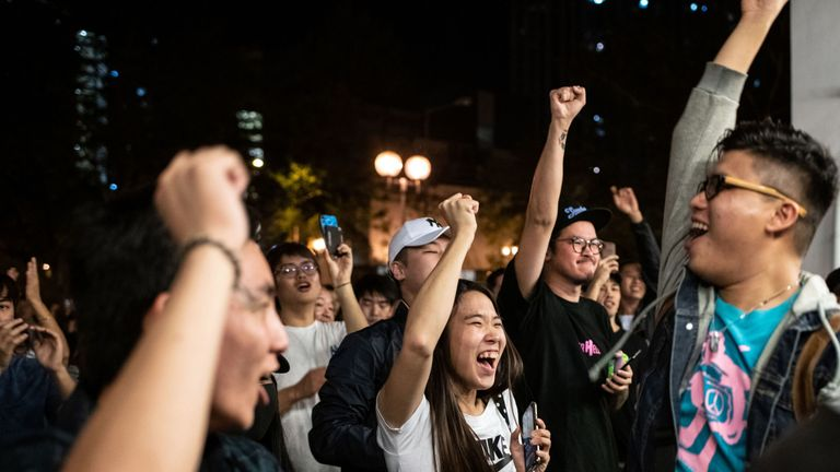 Pro-democracy supporters chant as they celebrate after pro-Beijing candidate Junius Ho lost a seat in the district council elections in Tuen Mun district of Hong Kong, early on November 25, 2019. - Hong Kong's voters turned out in record numbers for local council elections that the city's pro-democracy movement hopes will add pressure on the Beijing-backed government to heed their demands after months of violent protest. Lengthy queues snaked out of polling stations across the territory in the e