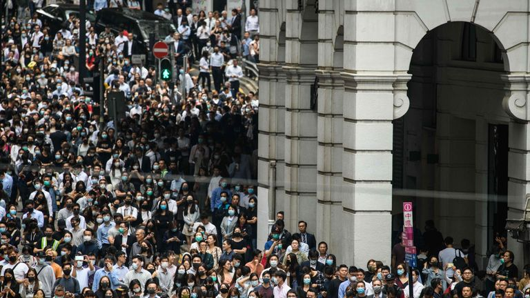 Thousands of office workers joined protesters on Hong Kong's famous Peddar Street during lunchtime on Tuesday