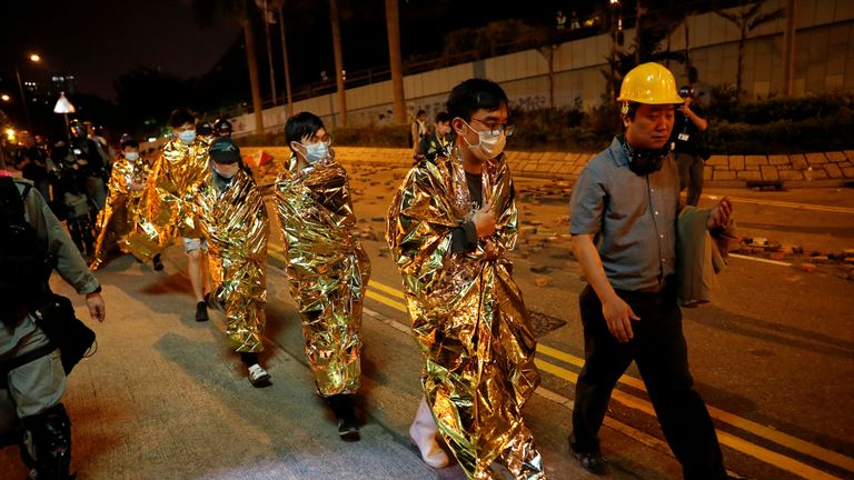 Surrended protesters were wrapped in foil sheets before being taken to hospital early on Tuesday