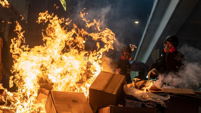 Pro-democracy protesters set a barricade fire during a demonstration in Causeway Bay