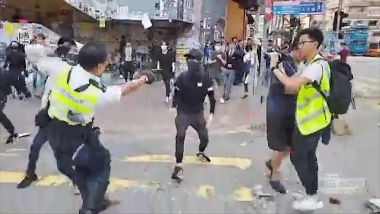 Police shoot at a protester in Hong Kong. Pic: Cupid Producer