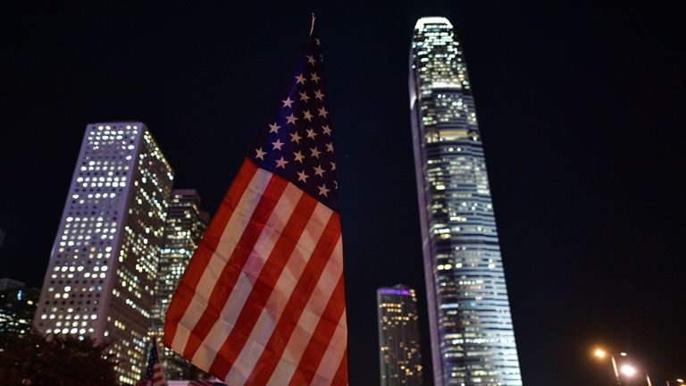 A US national flag is seen past buildings during a gathering of thanks at Edinburgh Place in Hong Kong's Central district