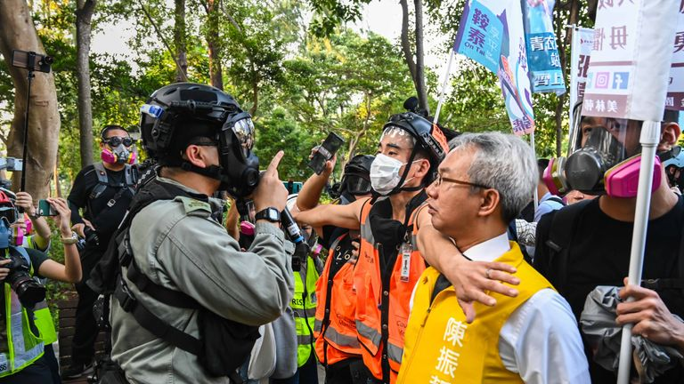 Richard Chan, a candidate for the district council elections, confronted police as they tried to clear protesters from Victoria Park