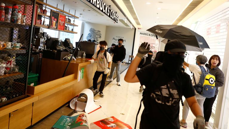 Clashes between police and protesters at a shopping centre in Hong Kong