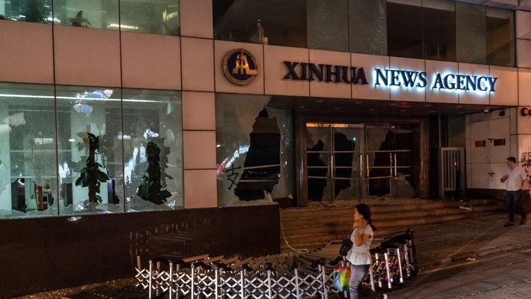 Protesters vandalised China's state news agency, Xin Hua, offices in Hong Kong