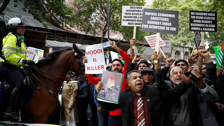 Anti-India supporters hold placards as they protest outside of the Indian High Commision in central London on August 15, 2019. - India's Prime Minister Narendra Modi's Hindu-nationalist government imposed direct rule on the Indian held portion of Kashmir on August 5, setting off a new crisis in one of the world's most volatile security flashpoints. Kashmir has been divided between Pakistan and India since independence from the British in 1947. (Photo by Tolga AKMEN / AFP) (Photo credit should re