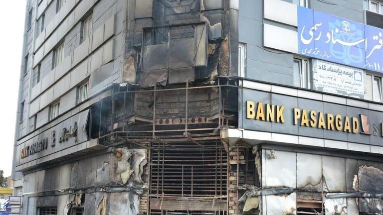 A scorched branch of Iranian Pasargad bank that was set on fire by protesters