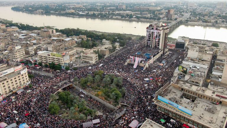 Thousands of Iraqi protesters gather at Baghdad's Tahrir Square on Saturday evening