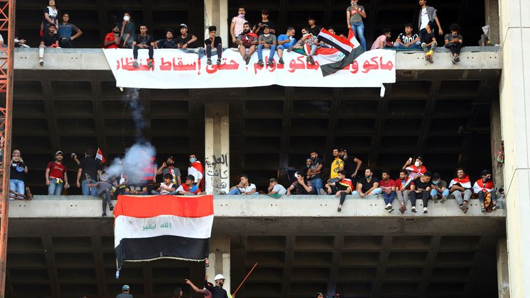 Iraqi protesters have taken over a derelict high rise building on the edge of Tahrir Square